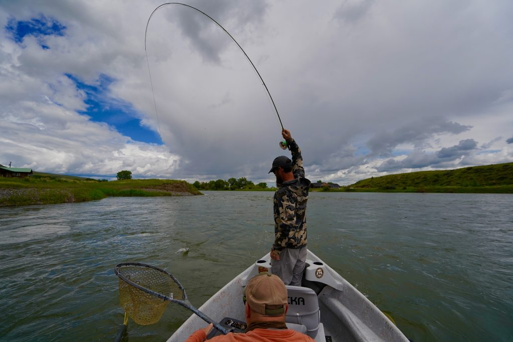 A fly-fisher is hooked up on a trout on The Missouri River in Montana